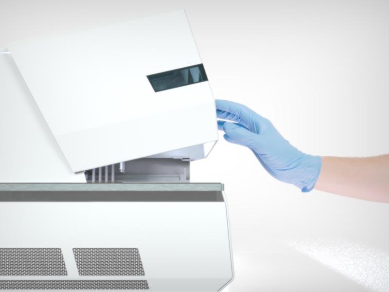 hand pushing open the BioXP 3200